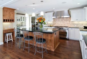 Traditional Kitchen with Corian Solid Surface Countertop in Deep Nocturne, U-shaped, Crown molding, Breakfast bar, Limestone