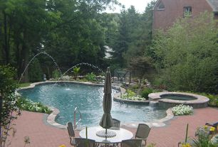 Traditional Swimming Pool with exterior brick floors, Casement, Pool with hot tub, Fountain, Fence