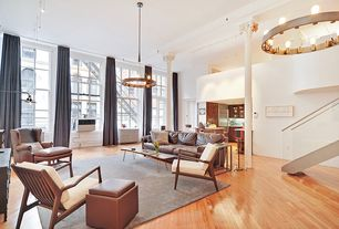 Contemporary Living Room with Loft, Chandelier, double-hung window, Built-in bookshelf, High ceiling, can lights, Columns