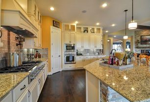 Traditional Kitchen with Inset cabinets, Standard height, L-shaped, Undermount sink, Custom hood, Stone Tile, Paint 1
