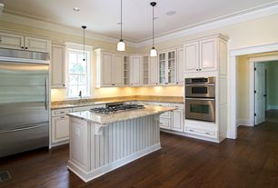 Traditional Kitchen with Glass panel, Pendant light, Kitchen island, Hardwood floors, Simple granite counters, Flush
