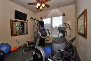 Traditional Home Gym with Concrete floors, Ceiling fan, Wall mounted tv, Carpet