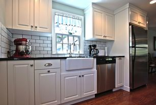 Country Kitchen with One-wall, Subway Tile, dishwasher, Built In Refrigerator, can lights, Soapstone counters, Raised panel