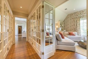 Traditional Hallway with Glass panel door, can lights, Crown molding, Standard height, Hardwood floors