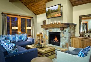 Eclectic Living Room with Birch lanekerry l-shaped sectional, stone fireplace, Exposed beam, High ceiling, limestone floors