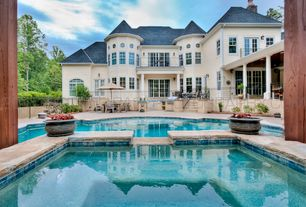 Traditional Swimming Pool with Outdoor kitchen, Screened porch, Deck Railing, Casement, exterior stone floors, Arched window