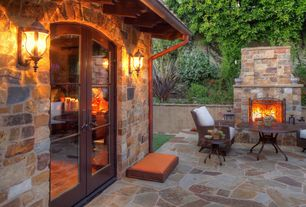 Mediterranean Patio with Fence, exterior stone floors, Raised beds, French doors