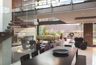 Contemporary Dining Room with Last Floor Lamp, Indoor/outdoor living, Concrete tile , Glass railing, Loft, Glass folding door