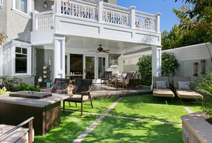 Traditional Patio with Raised beds, Casement, French doors, Fence, exterior stone floors, Pathway, Deck Railing
