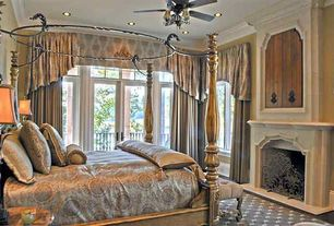 Traditional Master Bedroom with French doors, Transom window, Carpet, metal fireplace, Ceiling fan, Crown molding