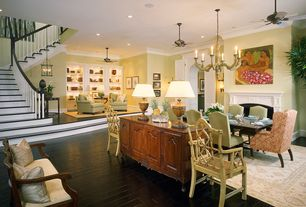 Eclectic Dining Room with French doors, Ceiling fan, Chandelier, Wall sconce, Hardwood floors, Crown molding