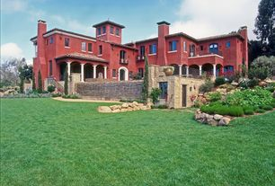 Mediterranean Landscape/Yard with Arched window, Casement, Deck Railing, French doors, Pathway, exterior stone floors