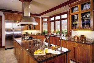 Traditional Kitchen with Bay window, Flat panel cabinets, L-shaped, limestone tile floors, Kitchen island, Flush, Glass panel