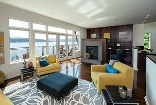 Contemporary Living Room with Built-in bookshelf, Laminate floors, French doors