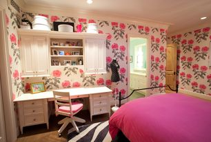 Traditional Kids Bedroom with Zebra safari area rug, Swivel desk chair, Hardwood floors, Floral wallpaper, Built-in bookshelf
