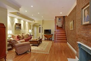 Traditional Living Room with metal fireplace, can lights, interior brick, Fireplace, Columns, Crown molding, Standard height