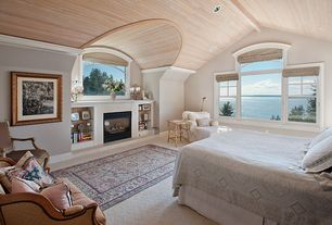 Cottage Master Bedroom with Built-in bookshelf, Cathedral ceiling, double-hung window, Carpet, Crown molding, can lights