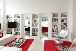 Modern Living Room with Hardwood floors, High ceiling, Nuloom handmade solid red rug, Metallic leather poufs, Crown molding
