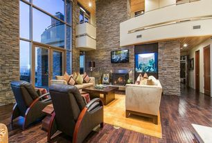 Contemporary Great Room with French doors, Transom window, Balcony, built-in acquarium, High ceiling, metal fireplace