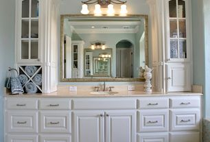 Traditional Master Bathroom with Limestone counters, Limestone, specialty door, Glass panel, Undermount sink, Master bathroom