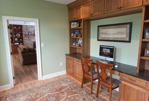 Traditional Home Office with Built-in bookshelf, Hardwood floors
