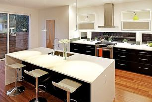 Modern Kitchen with One-wall, Kitchen island, Glass panel, Undermount sink, Breakfast bar, Corian counters, Pendant light