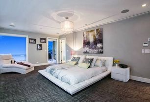 Contemporary Master Bedroom with White tufted platform bed, Carpet, Chandelier, Crown molding, Platform bed, French doors