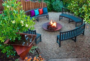 Eclectic Landscape/Yard with Bird bath, Fire pit, Sculptural metal birdbath, Fence, Curved outdoor bench, Throw pillow