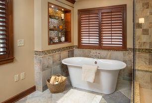 Eclectic Master Bathroom with Custom Interior Shutters, Freestanding, slate tile floors, frameless showerdoor