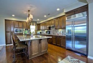Craftsman Kitchen with Breakfast bar, Hardwood floors, Kitchen island, Inset cabinets, Undermount sink, Stone Tile, L-shaped