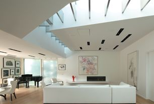Contemporary Living Room with Laminate floors, High ceiling, Exposed beam