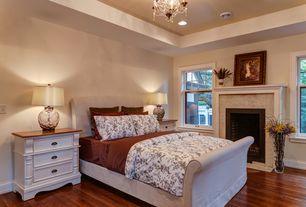 Traditional Guest Bedroom with Chandelier, Hardwood floors