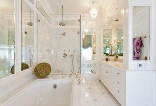 Traditional Master Bathroom with can lights, Chandelier, stone tile floors, frameless showerdoor, drop in bathtub, Bathtub