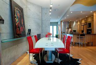 Modern Dining Room with Pendant light, High ceiling, Laminate floors