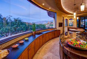 Mediterranean Kitchen with Soapstone counters, can lights, full backsplash, dishwasher, High ceiling, limestone tile floors