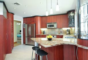 Contemporary Kitchen with Breakfast bar, stone tile floors, Pendant light, electric cooktop, built-in microwave, U-shaped