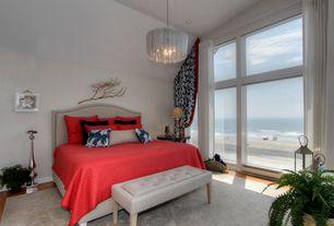 Eclectic Master Bedroom with Laminate floors, Chandelier