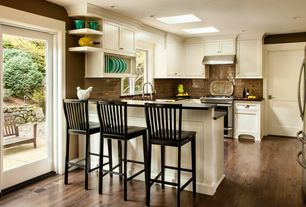 Modern Kitchen with Soapstone counters, Undermount sink, Flat panel cabinets, U-shaped, Breakfast bar, Skylight, French doors