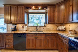 Country Kitchen with Simple granite counters, stone tile floors, Flat panel cabinets, gas range, electric cooktop, L-shaped