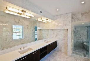 Contemporary Master Bathroom with stone tile floors, wall-mounted above mirror bathroom light, Bathtub, frameless showerdoor