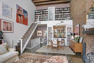 Modern Great Room with Built-in bookshelf, can lights, brick fireplace, Loft, Cathedral ceiling, Hardwood floors, Fireplace