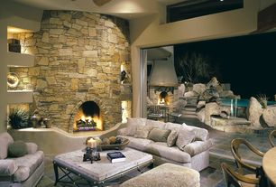 Rustic Great Room with soapstone tile floors, Olive wood deep tray, stone tile floors, Transom window, can lights, Fireplace