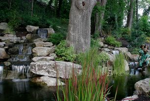 Rustic Landscape/Yard with exterior stone floors, Fence, Fountain, Pathway, Pond