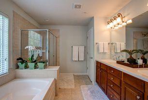 Traditional Master Bathroom with framed showerdoor, Limestone counters, stone tile floors, Undermount sink, Raised panel