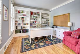 Traditional Home Office with Hardwood floors, Crown molding, Standard height, Built-in bookshelf