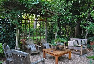 Traditional Landscape/Yard with Wood outdoor seating, Trellis, Gravel