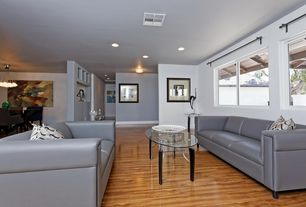 Modern Living Room with Hardwood floors, Standard height, can lights, Casement, Built-in bookshelf