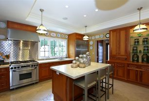 Craftsman Kitchen with Flat panel cabinets, L-shaped, limestone tile floors, Inset cabinets, Kitchen island, Breakfast bar