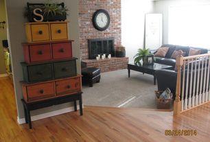 Rustic Living Room with Sunken living room, metal fireplace, Brick, Fireplace insert, Carpet