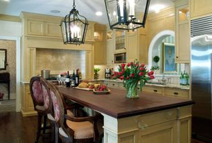 Traditional Kitchen with Complex granite counters, L-shaped, Flat panel cabinets, Large Ceramic Tile, Crown molding